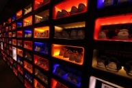 plain shoes in colorful cupboards