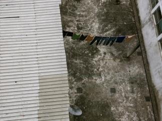 clothes hang to dry in a backyard in Xilitla, San Luis Potosí