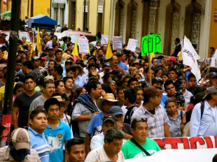 varied facial expressions during a march to protest the lack of explanation to the whereabouts of missing students in Ayotzinapa. Oaxaca, Oaxaca