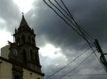 dark church tower and telephone lines in Durango, Durango