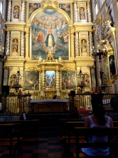 a woman has a private conversation with her god in a cathedral in Puebla, Puebla