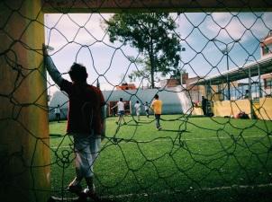 the goalie takes a break during a soccer match. Puebla, Puebla