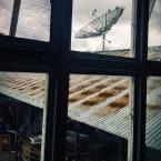pigeons lounge on a satellite dish. Atlixco, Puebla