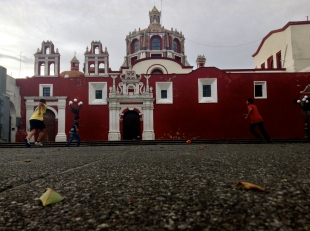 children play an impromptu soccer match on the grounds of a church. Puebla, Puebla