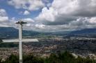 a cross watches over a city of shadows cast upon it, Quetzaltenango, Guatemala