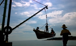 fishermen bring in the catch of the day in Puerto Libertad, El Salvador