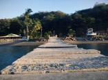 sloppy slabbing, wobbly wharfing, precarious piering, DIY docking, messy muelle con toca de tico, Playa Flamingo, Costa Rica