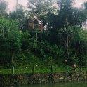 A girl walks along the edge of the lake in her home town of Ecoaldea Feliz, Cundinamarca