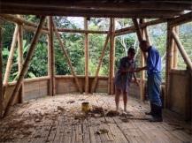 Julietta and Gabriel take a break from throwing mud at walls, Ecoaldea Feliz, Cundinamarca