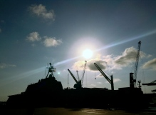 A U.S. navy ship hides in the silhouette of the afternoon Caribbean sky of Puerto Cartagena