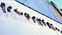 surreal collection of babies on a wall, Bogotá