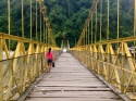 A girl takes a small bag of groceries to the other side of her town crossing the Río Cauca, Antioquia