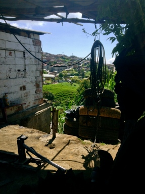 The owner of a tire shop with a nice view of the local town helped me top up the air in my tire, Antioquia