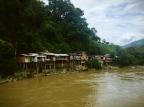 Shanty houses along the bank of the Río Cauca, Antioquia