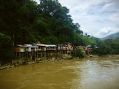 Shanty houses along the bank of the Río Cauca, Antioquia