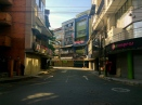 A security guard watches over a lonely street in Medellín's city center