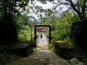 Crossing a bridge into the hands of Colombian hospitality and swimming holes, Antioquia