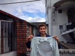 A handsome man holds up a shirt for some reason, Bogotá