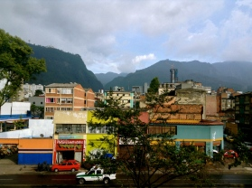 Atop the mountain, Monserrate keeps watch on the police keeping watch on streets, Bogotá