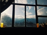 The surrounding mountains of Bogotá in the early morning light filtered through a dirty window. Bogotá
