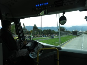 Protesters march up the 26th while the buses go about their business, Bogotá