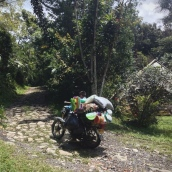 A plastic wares delivery boy packs his bike to the limit, Ecoaldea Feliz, Cundinamarca