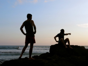 two sunset admirers miss out on a surfer catching a chill wave, Montañitas