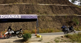 The tiny border between Ecuador and Perú, just one motorcycle cop and an old man in a little shack that types one finger at time. Piura