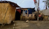 A sad pup lies tethered to a pole in the yard of his desert slum house. You would never guess that on the inside of that house is a comfy living room with flat screen TV, surround sound system and glass cabinets of fake fine china. Huarmey