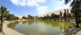 This is an unnaturally natural oasis in the peruvian atacama desert. It was discovered filled with water as seen here, then used up by humans, then drained by human consumption, then refilled for tourism purposes. Huacachina