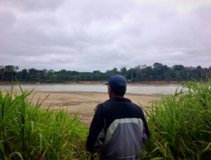 Guillermo looks out onto the shores of Río Madre de Dios from Isla de los Monos (monkey island). He traverses this river daily carrying people up and down in his humble motorboat. He remembers when there were still indigenous living in their more ancient traditions here. Nowadays they might be found drinking coca cola.