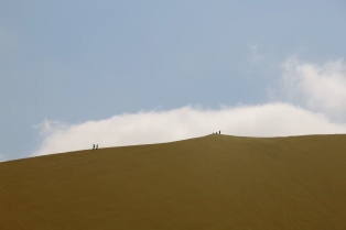 Dune trekkers pace the edge of an uneven horizon. Huacachina