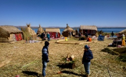 Two strangers meet, the unstable ground below their feet keeps them floating while their eyes keep them fixated. Floating Islands of Uros, Lake Titicaca.