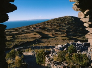 The humble lands of Amantani through an ancient archway. Lake Titicaca.