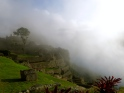 An early morning mist of a brand new day touches the face of an ancient city. Machu Picchu