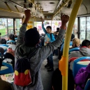 Young rappers making their daily bread on an inner city bus of Lima