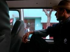Pensive combi rides through Lima