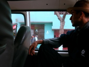 Pensive combi rides through Lima